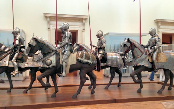 statues of men and horses with armor