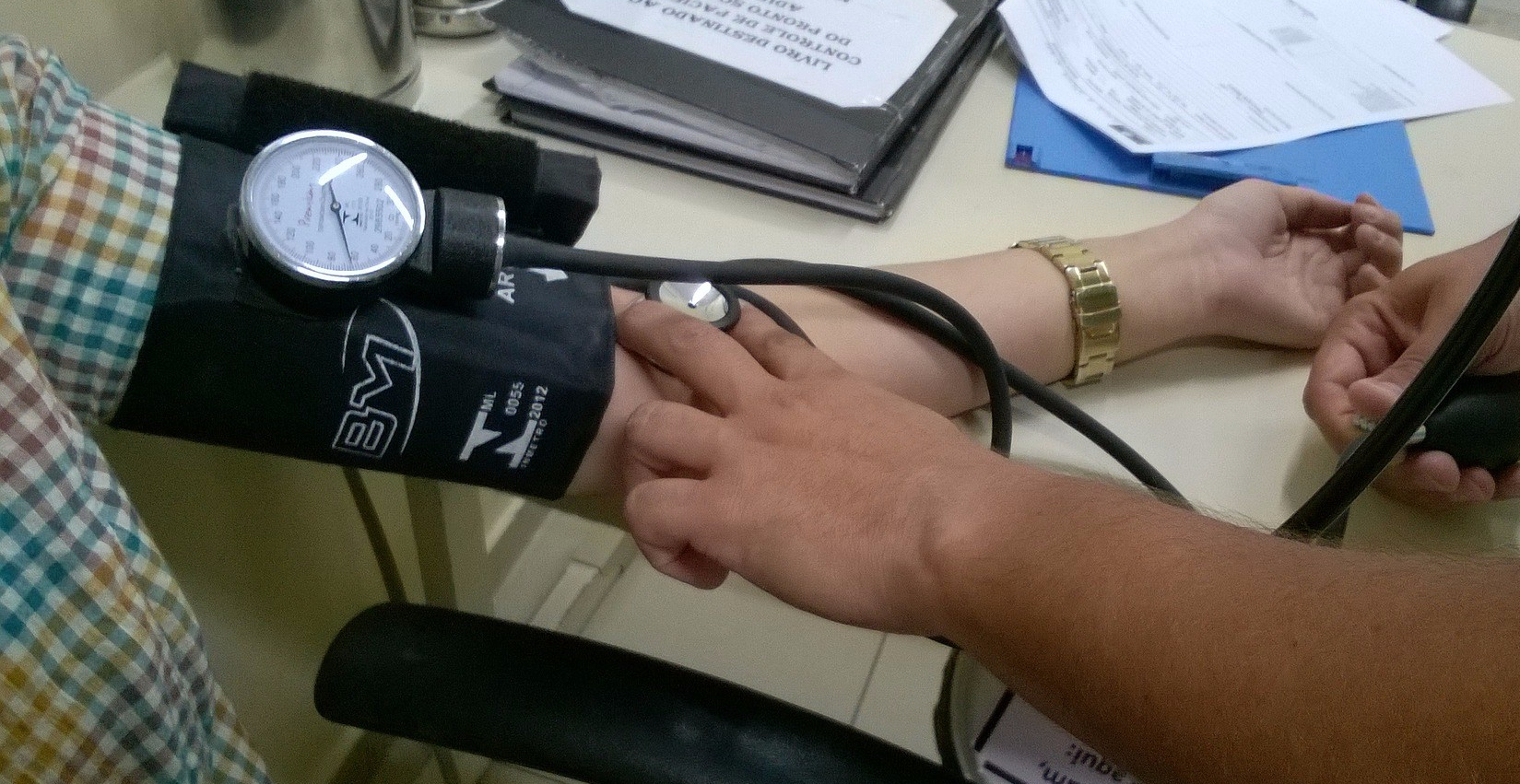 a person having blood pressure measured