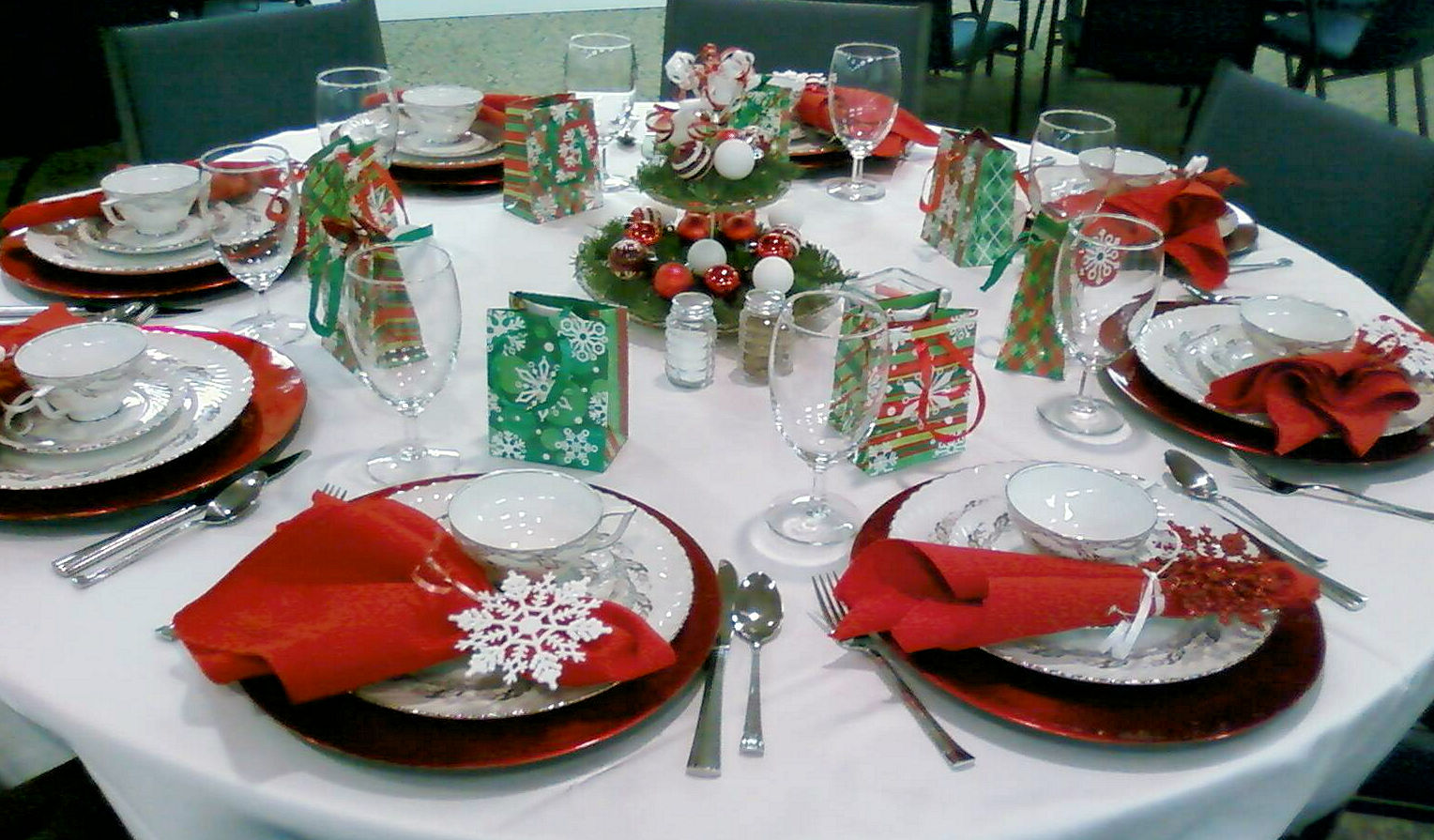 a dining table decorated for Christmas