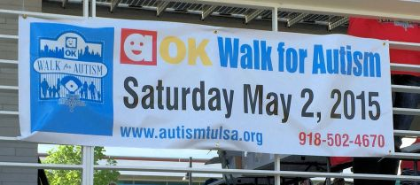 "a banner reading ""aok Walk for Autism"