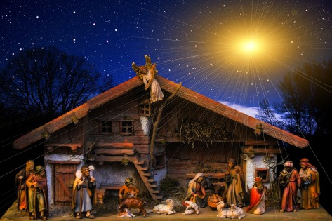 figures in a nativity scene with a bright start in the sky