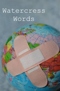 Watercress Words- a world globe with 2 band-aids crossed
