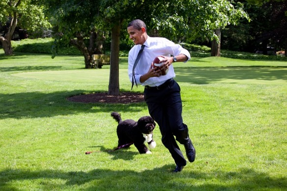 Former President Obama running with his dog