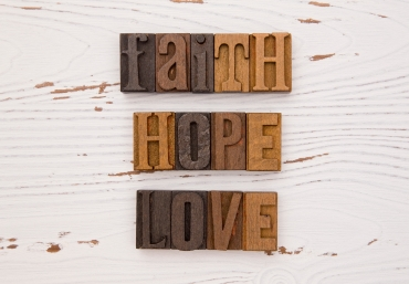 FAITH, HOPE, LOVE in wooden block letters