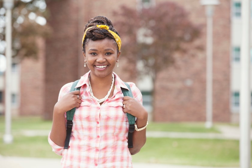 an African American young woman smiling