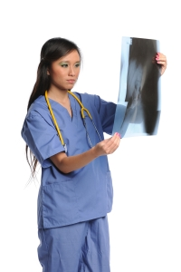 Female doctor looking at an xray