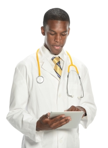 a male doctor using a tablet while working