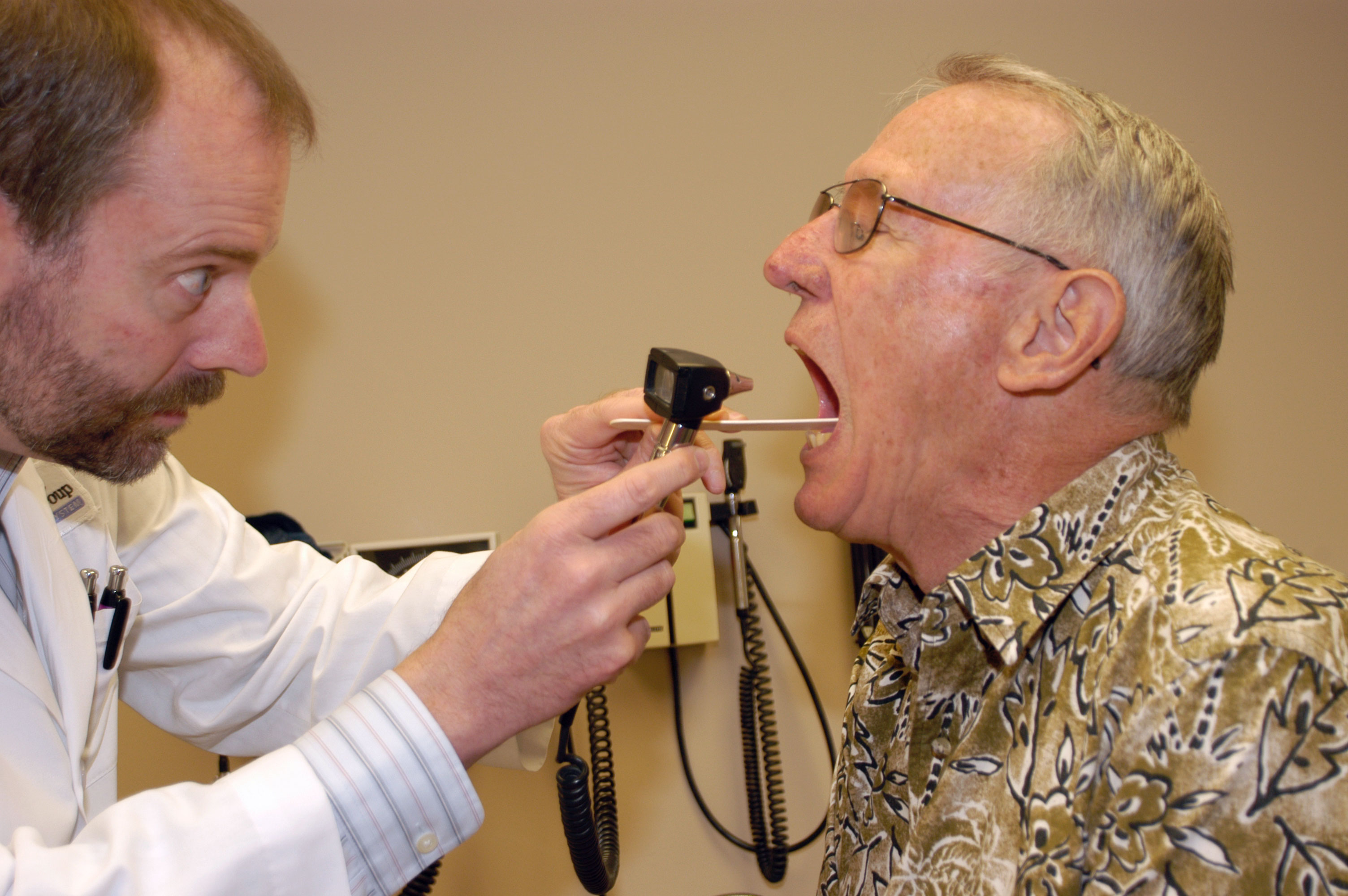 a doctor looking into a patient's mouth