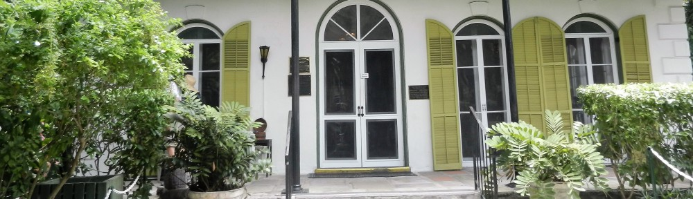 a white house with green shutters-Ernest Hemingway's Key West house