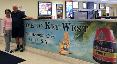 man and woman with Key West visitor sign