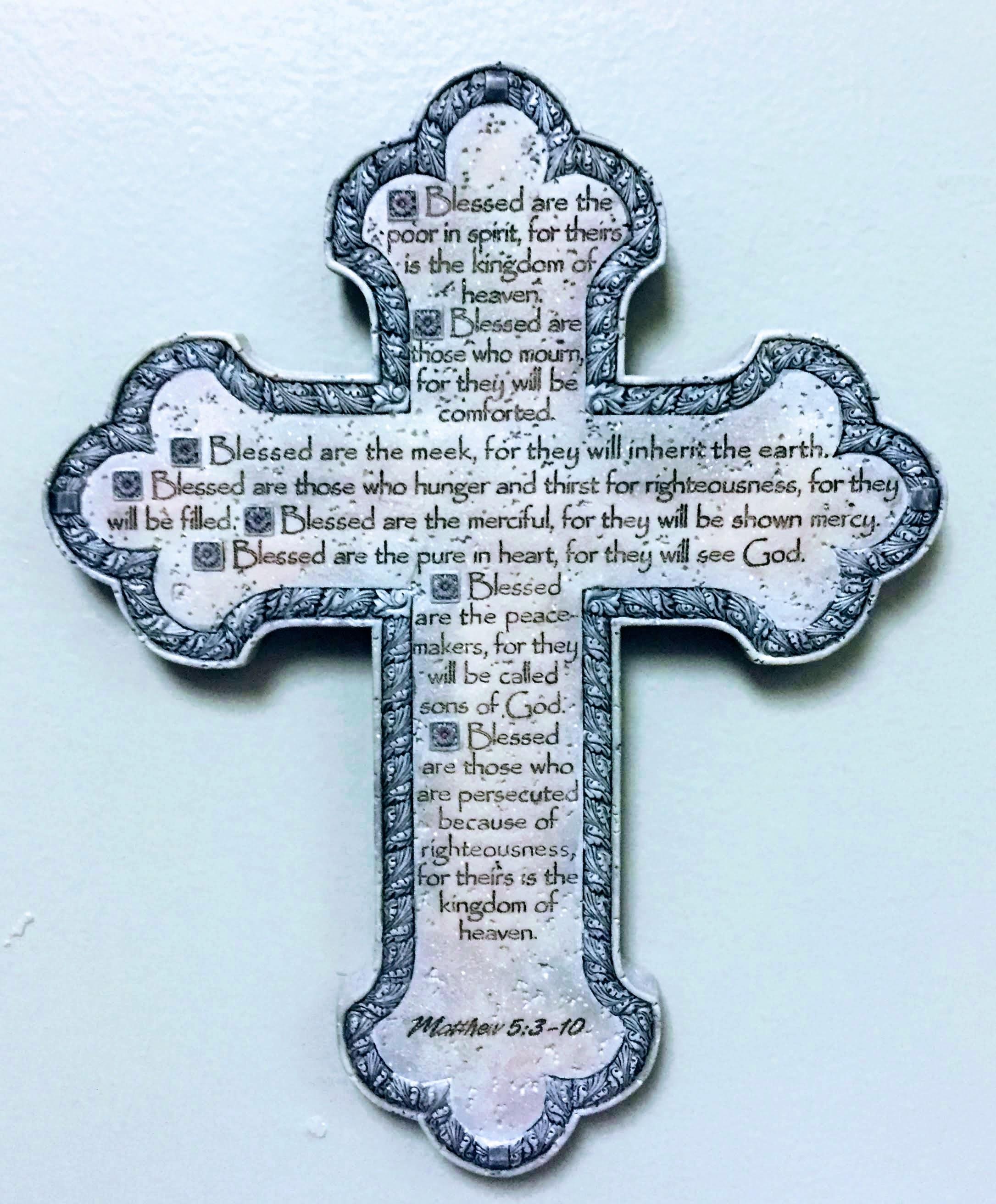 a ceramic cross with the Beatitudes Matthew 5:3-10
