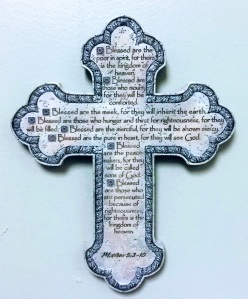 a ceramic cross with the Beatitudes Matthew 5:3-10