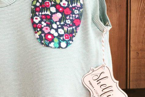 a shirt with a tag-shelfie