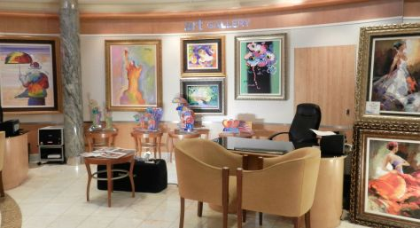 an art gallery with bright colored pictures