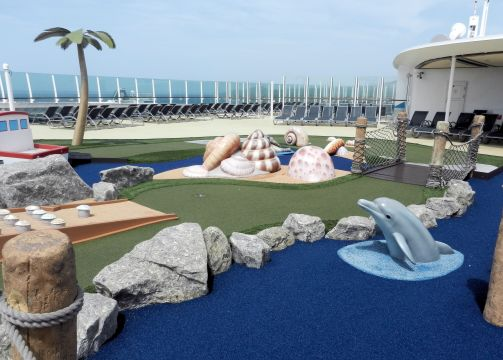 a mini golf course with a beach theme