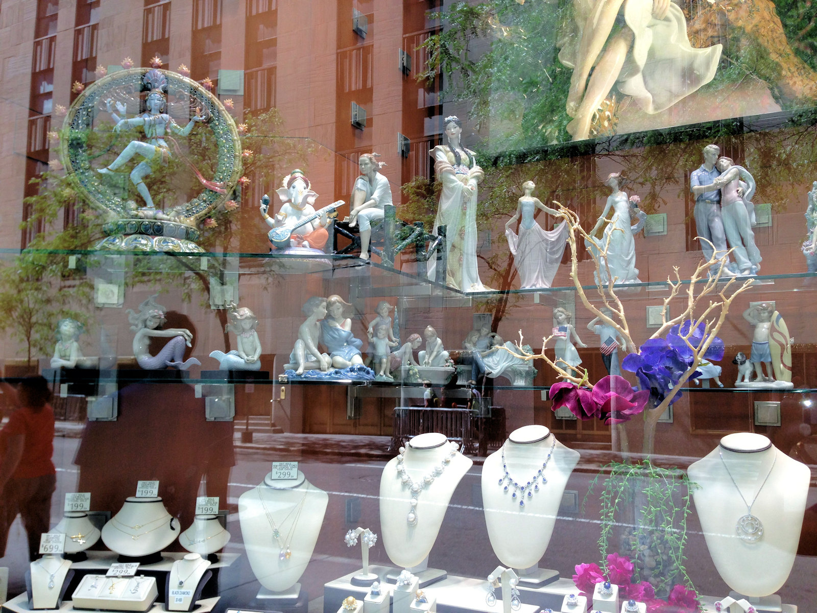 jewelry and ceramic figurines in a store window