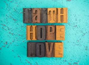 faith, hope, love spelled out in wooden block letters