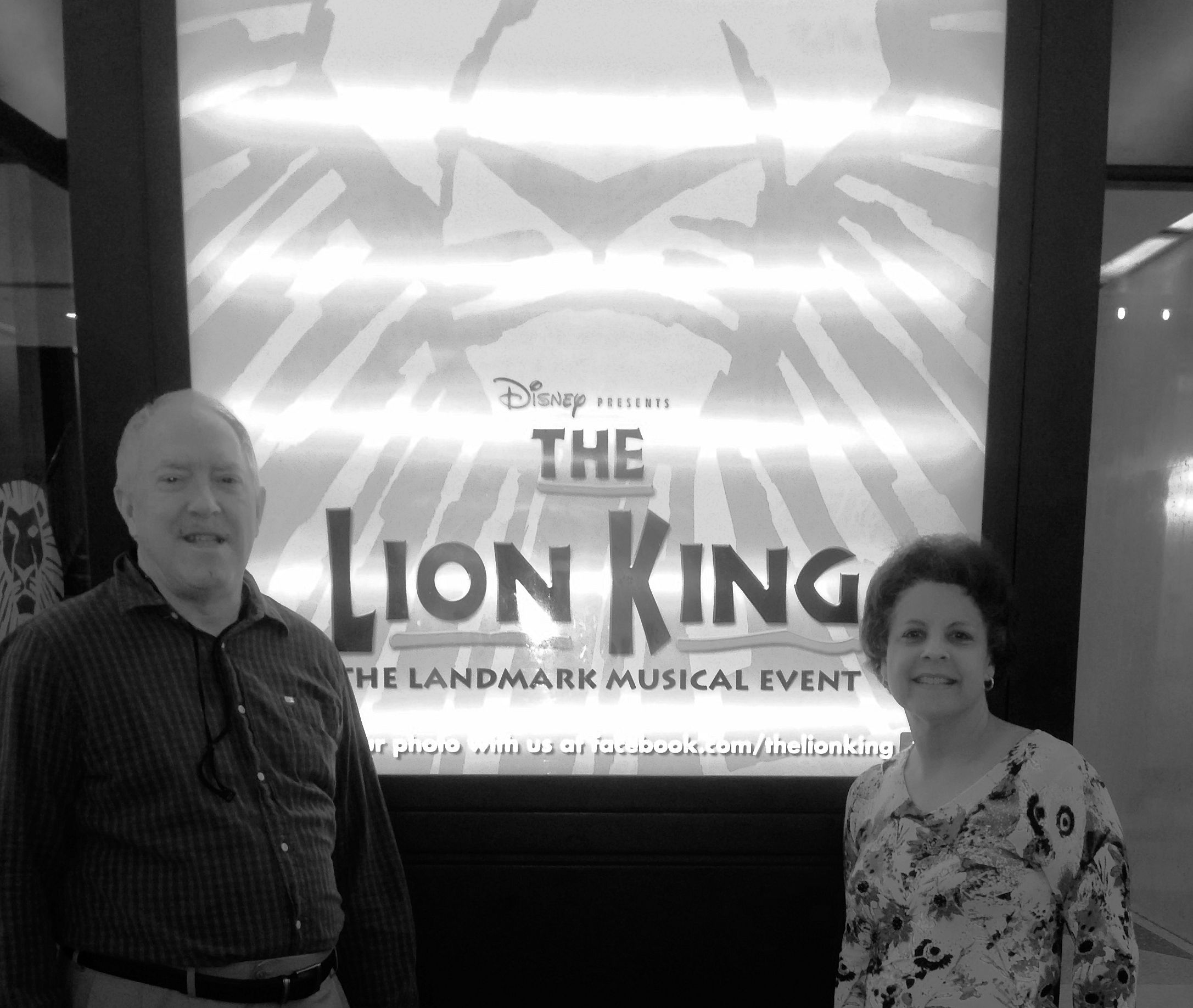 couple in front of THE LION KING sign