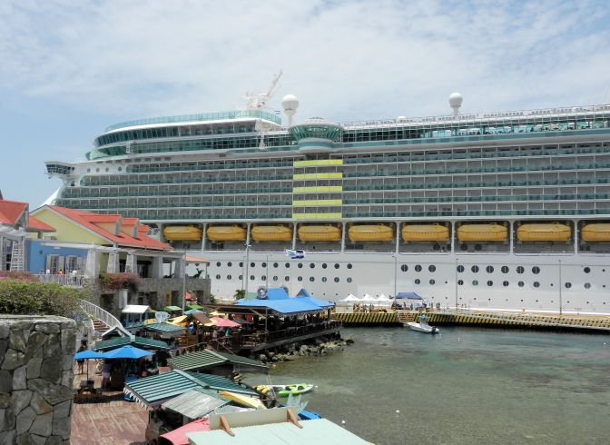 a cruise ship docked in a port