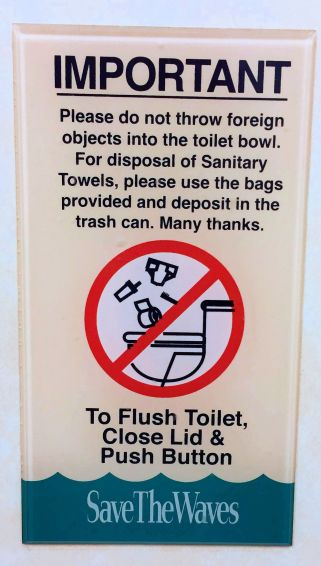 a sign- IMPORTANT-please do not throw foreign objects into the toilet bowl.
