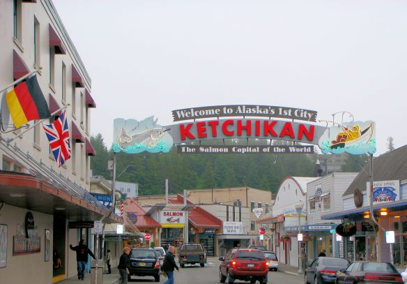 a street in Ketchikan Alaska with a sign-The Salmon Capital of the World
