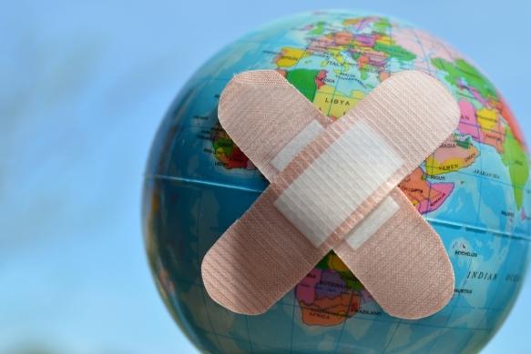bandaids on a world globe