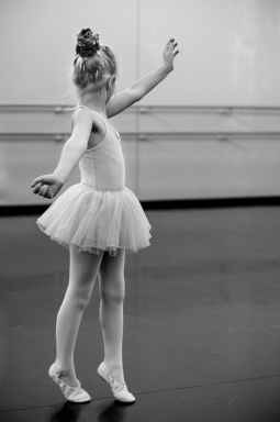 grayscale photography of young girl doing ballet