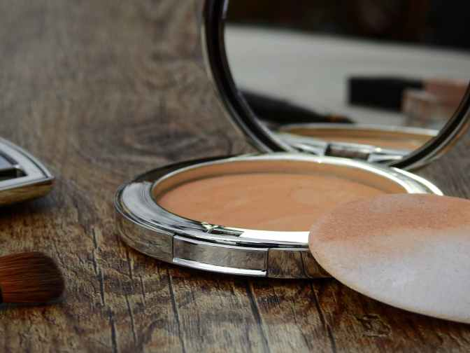 compact makeup with a mirror and sponge