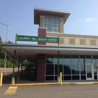 a building with sign-Squirrel Hill Health Center