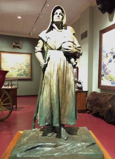 statue of a pioneer woman with rifle and infant