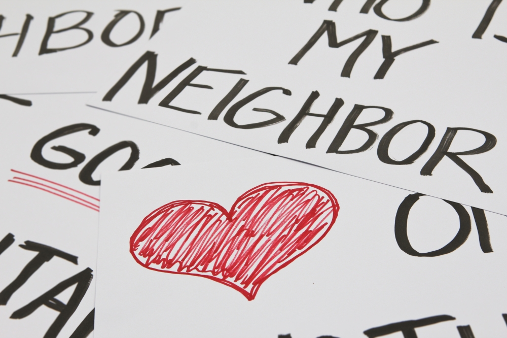 a hand drawn red heart and the word NEIGHBOR