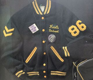 a letter jacket, bag, and shoes, belonging to Kristen Chenoweth