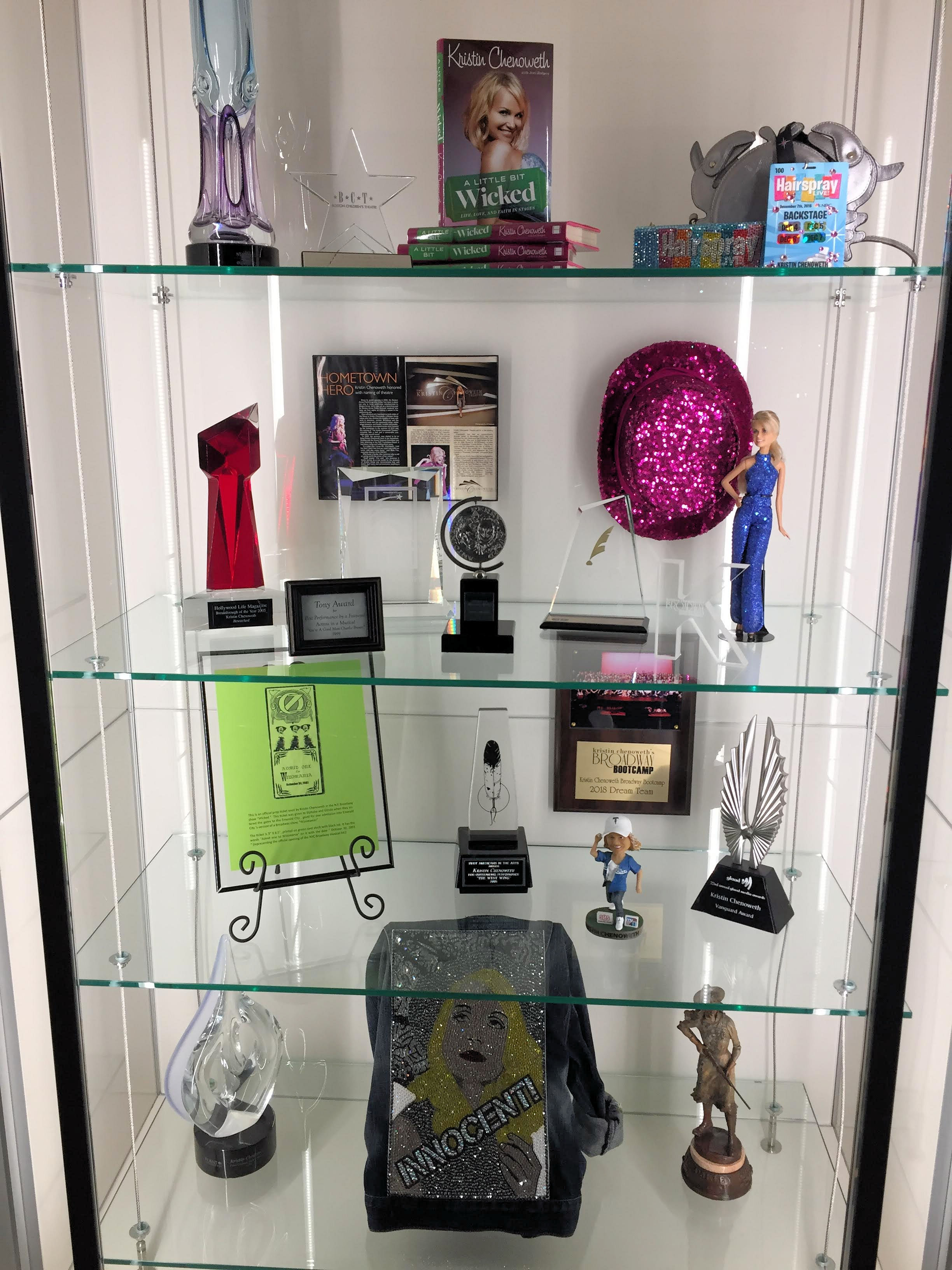 a display case with trophies belonging to Kristen Chenoweth
