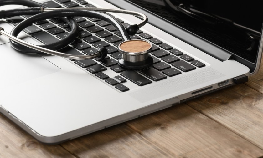 Stethoscope on the keyboard of a laptop