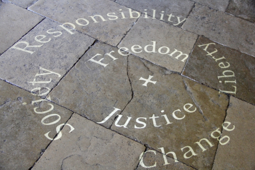 a stone sidewalk with overlying words-responsibility, society, freedom, liberty