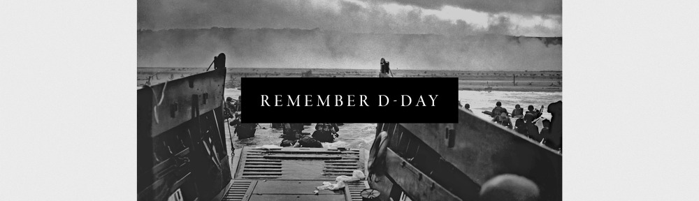 REMEMBER D-DAY- a ship with soldiers walking out into the water