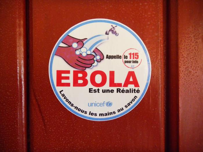 "sign which says EBOLA, ""wash hands with soap"""