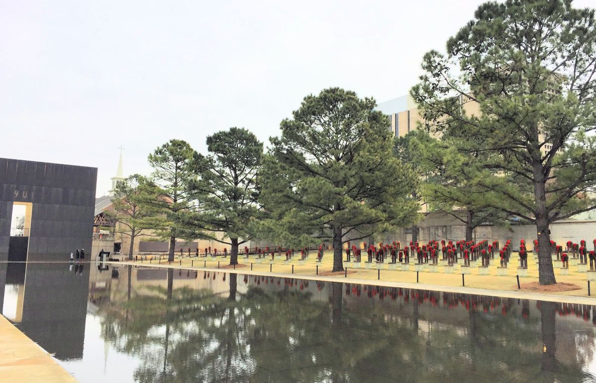 the reflecting pool and memorial chairs at the Oklahoma City Memorial