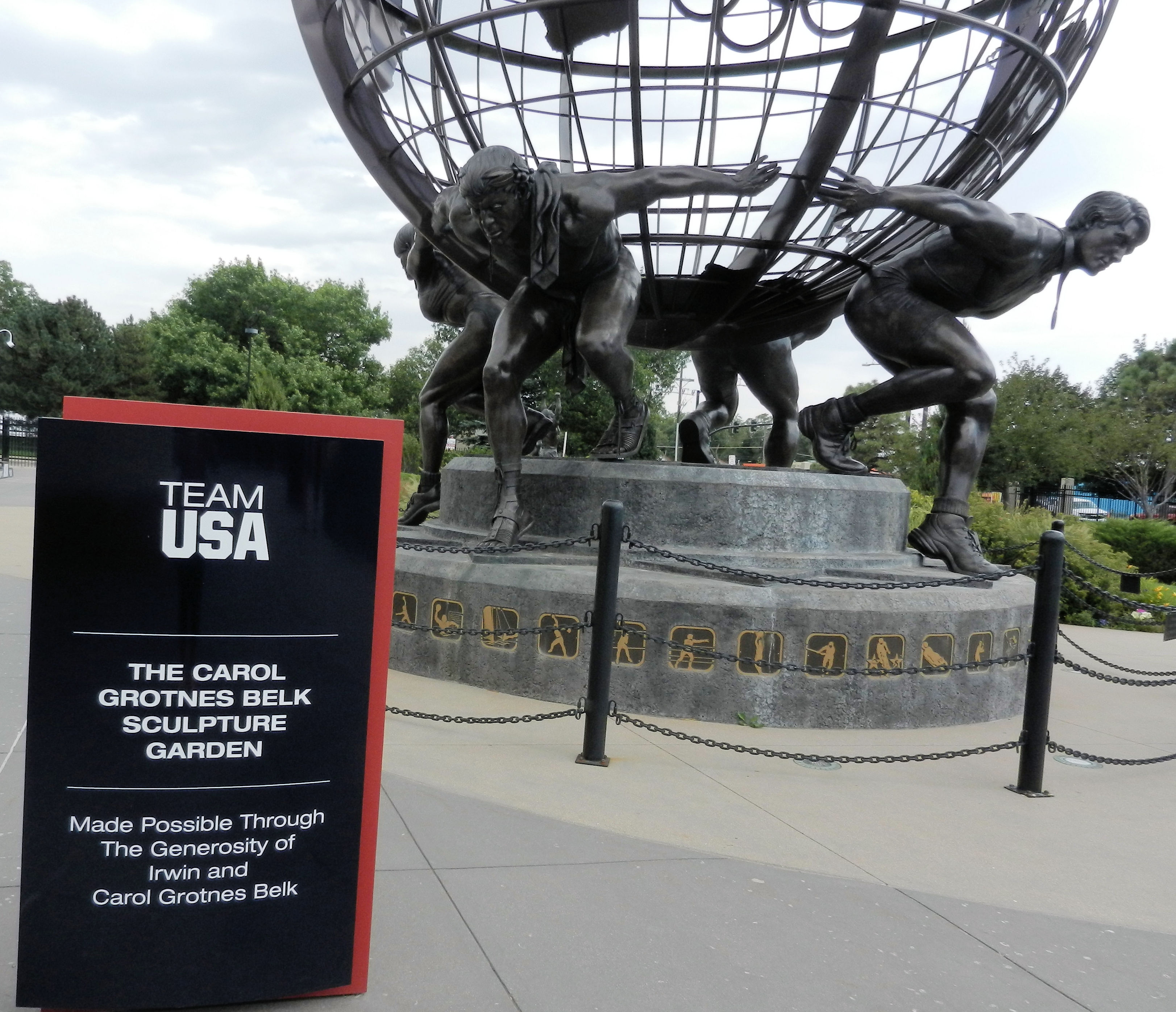 bronze globe supported on the backs of 4 athletes