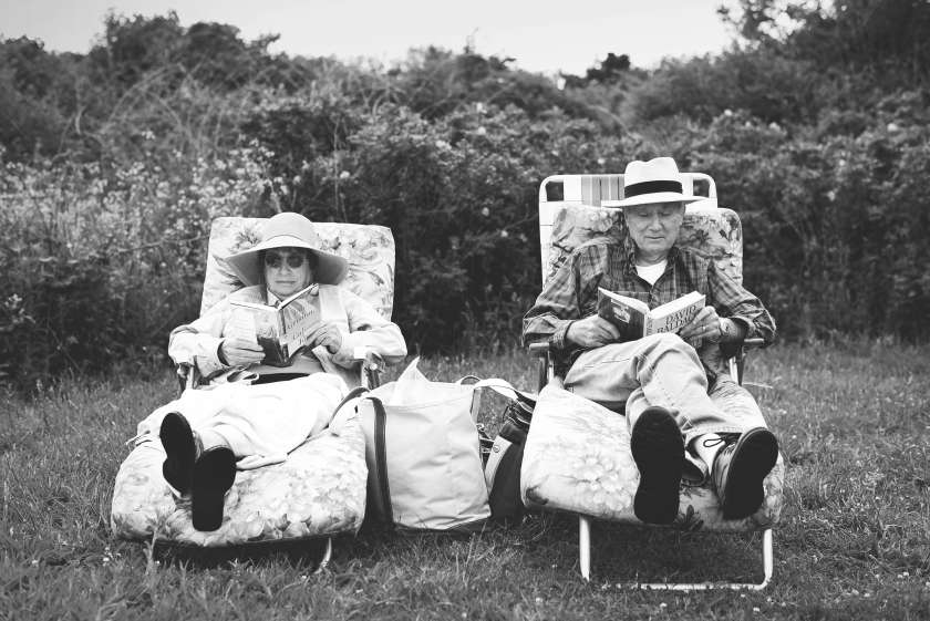 a senior adult couple relaxing in lawn chairs
