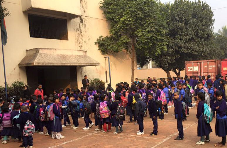 children standing outside a school in Bangladesh