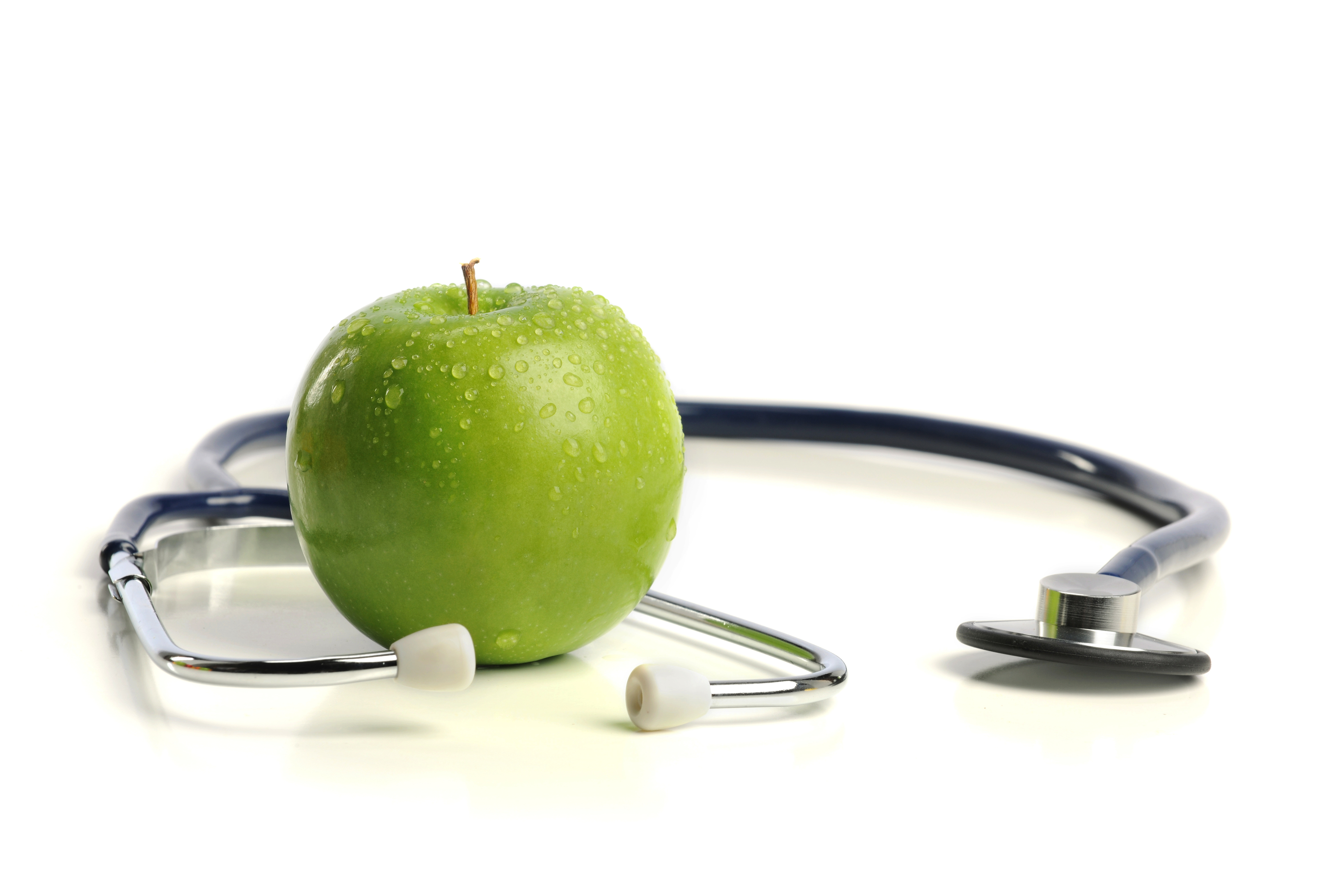 Stethoscope and Apple isolated on a white background