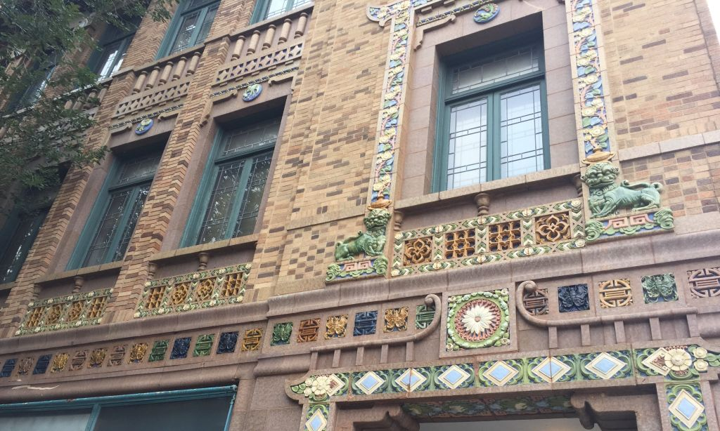a brick building decorated with Chinese art