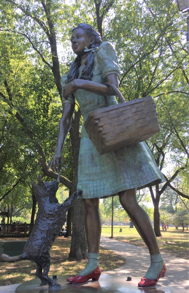 a statue of Dorothy and Toto from the Wizard of Oz
