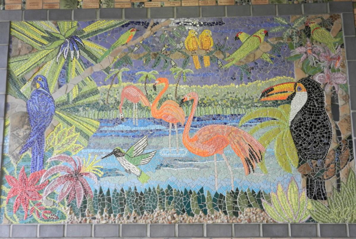a mosaic tile mural featuring tropical birds, parrots, flamingos,