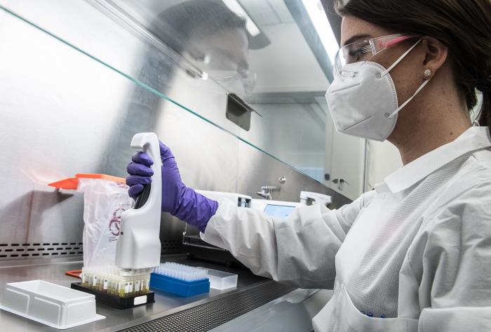 a scientist in a lab working on covid antibodies