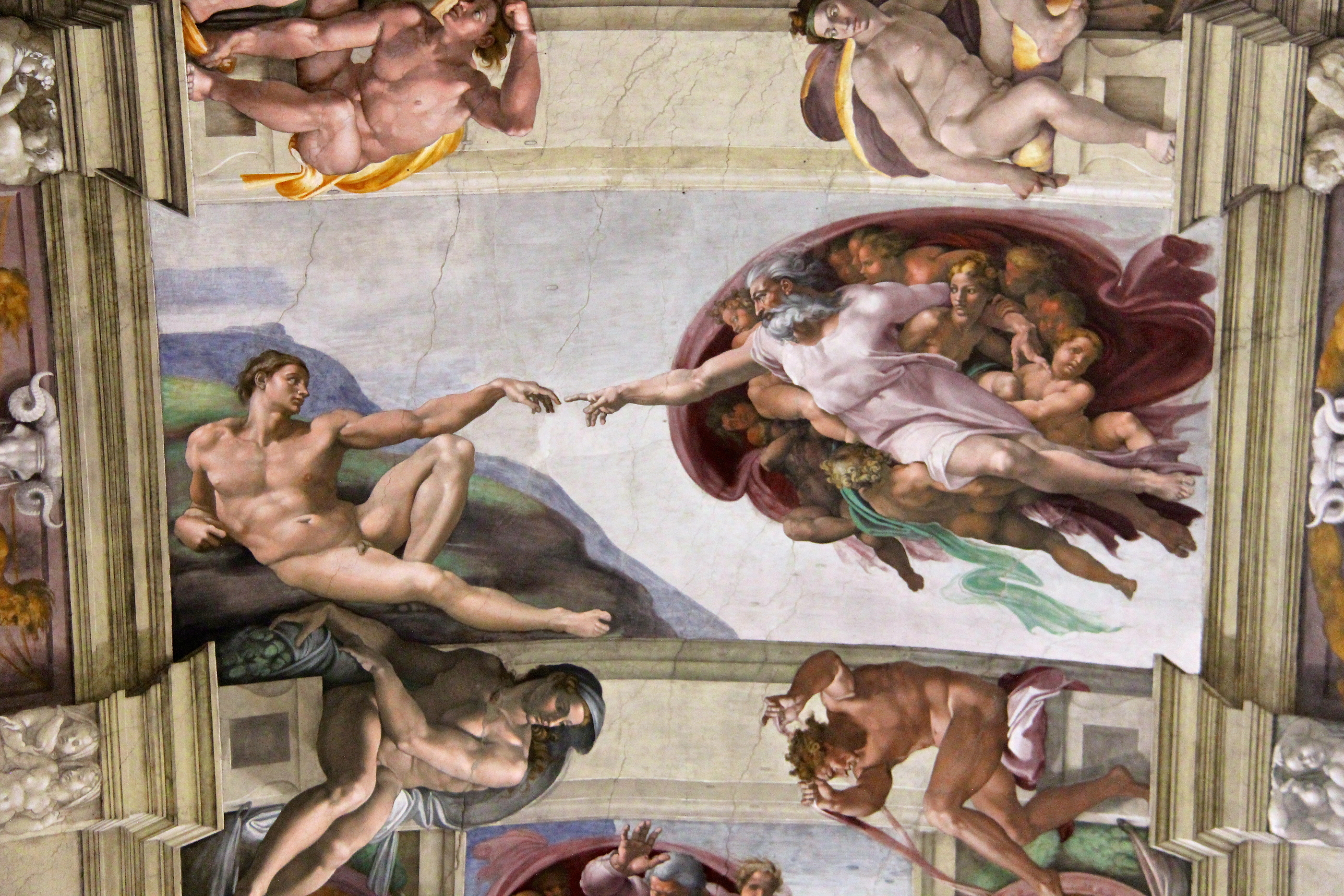 image of God and Adam on the Sistine Chapel by Michelangelo
